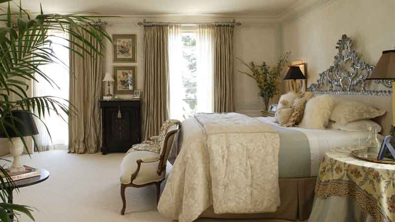Rolling Hills Master Bedroom with Vintage Headboard by KeyVision Interiors